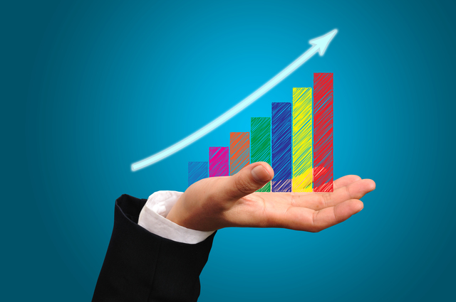 Business Growth Graph on Male Hand