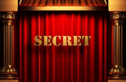 secret golden word on red curtain